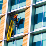 window cleaner on tall office building